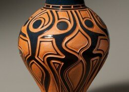 Garry Childs - Potter from Rougemont, NC - creates functional terra cotta wheel-thrown pots with carved patterns and layers of colorful glaze and pigments.