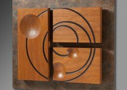 Craig Kassan, Woodworker in Franklinton, NC turns wood to create wall sculptures, hollow forms, burl dishes and natural edge hollow spheres.