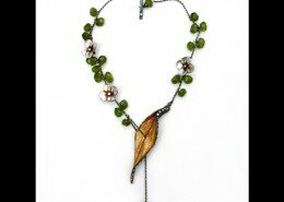 Kristi Hyde, Jeweler in Atlanta, Georgia, hand sculpts, polishes and finishes earrings, bracelets and necklaces with botanical designs inspired by nature.