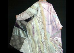 Mimi Hay Fiber Artist in NC creates jackets, skirts, dresses and kimonos collaged with fabrics; embellished with paint, embroidered, quilted or hand-beaded.