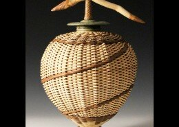 Stephen Kostyshyn Mixed Media Artist in Cedar, MI hand assembles and weaves his red osier, birch bark and palm pieces with wheel thrown and altered clay.
