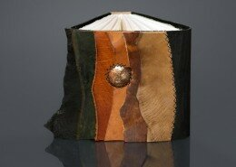 Teresa Merriman Mixed Media Artist of Mind's Eye Journals in Colorado uses traditional and contemporary bookbinding methods to create journals out of leather, handmade or watercolor paper and acid-etched metals.