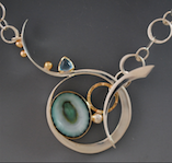 Barbara Umbel, jeweler in Indian Harbour Beach, Florida, creates pendants, necklaces and bracelets with precious metals, gemstones, sea shells or sea urchins.