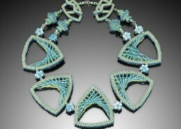 Kathy King, jeweler in Cary, NC, creates intricate beaded necklaces, bracelets and earrings inspired by architecture and colors from around the world.