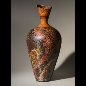James Barnes, woodworker in Woolwine, Virginia, creates turned wood vessels with inlay and metal to design original, one-of-a-kind wood cloisonné sculpture.