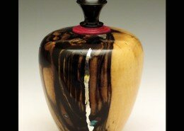 John M. Russell, Woodworker in Linden, Virginia lathe turns wood vessels and writing tools with inlaid semi-precious gems, pewter, applied gold or silver wire.