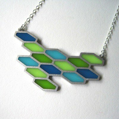 Kathleen Dautel, Jeweler in Raleigh, North Carolina creates modern stainless steel and resin jewelry of original designs inspired by nature and architecture.