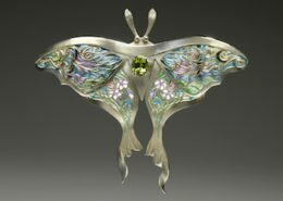 Linda Caristo, Jeweler in Fairview, NC, creates delicate translucent resin within hand pierced cells to create unique jewelry in an array of colors inspired by the natural beauty of Western North Carolina.