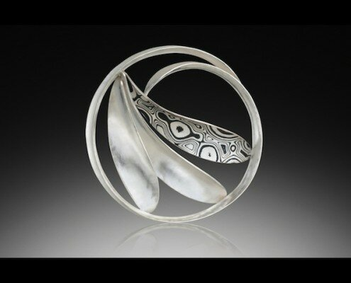 Theresa Kwong, Jeweler in San Mateo, CA creates necklaces, earrings, cuffs, brooches and rings using recycled sterling silver, 18k bimetal and mokume gane.