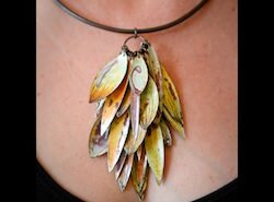 Annie Grimes Williams, jeweler in Winston-Salem, NC, creates unique colorful earrings, necklaces and bracelets using traditional metalsmithing and enameling