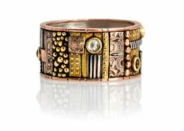 Lynda Bahr, Jeweler in San Gregorio, CA, creates one-of-a-kind rings, earrings and bracelets with mosaics of sterling silver, golds and precious stones.