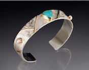 Mary Timmer, jeweler in Asheville, NC, creates elegant hand crafted rings, earrings and bracelets using sterling silver, gold, pearls and precious stones.