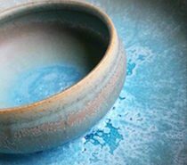 Delores Hayes, potter in Durham, NC, creates functional and decorative ceramic wares on a potters wheel.