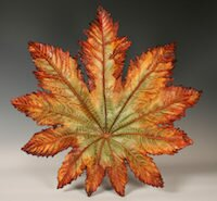 John Wayne Jackson, mixed media artist in Black Mountain, NC, creates contemporary sculptures using real leaves, a stone medium, and paint.