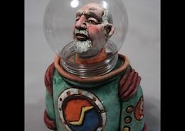 John Tobin, ceramic artist in Chesapeake, VA, creates sculpted figures from stoneware clay finished with a copper oxide wash and acrylic paint under